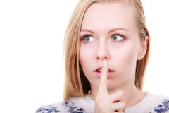 Young blonde woman making silence gesture Stock Image