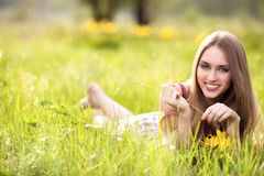 Young blonde woman on the meadow Royalty Free Stock Images