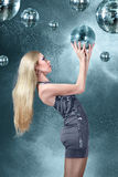 Young blonde woman at night disco club Stock Photography