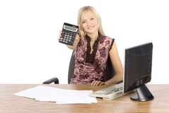 Young blonde woman with in the office with calculator Royalty Free Stock Images