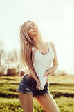 Young blonde woman outdoors sexual portrait Stock Photo