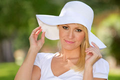 A Young Blonde Woman Outside. A blonde young woman outside in nature royalty free stock photography