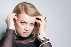 Young blonde woman with pearl jewelry Royalty Free Stock Image