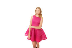 Young blonde woman with pink skirt Stock Images