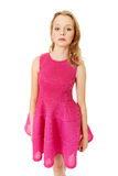 Young blonde woman with pink skirt Royalty Free Stock Photo
