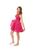 Young blonde woman with pink skirt Royalty Free Stock Image