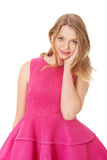 Young blonde woman with pink skirt Royalty Free Stock Photography