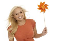 Young blonde woman with pinwheel smiling Royalty Free Stock Photo