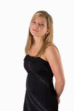 Young blonde woman portrait black dress. Portrait of a beautiful young blonde woman smiling in a black dress isolated on a white background royalty free stock image
