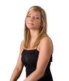 Young blonde woman portrait black dress. Portrait of a beautiful young blonde woman in a black dress isolated on a white background royalty free stock images