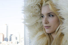 Young blonde Woman portrait with fur coat Stock Photo