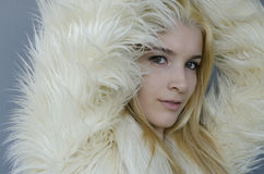 Young blonde Woman portrait with fur coat Royalty Free Stock Image