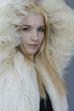 Young blonde Woman portrait with fur coat Stock Image