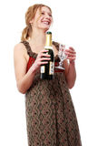 Young blonde woman pouring on champagne to the wineglass Royalty Free Stock Photo