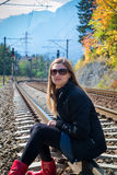 Young blonde woman on railroad Stock Photography