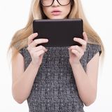 Young blonde woman reading on tablet Royalty Free Stock Photo
