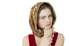Young blonde woman in a red golden scarf Stock Image