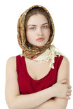 Young blonde woman in a red golden scarf Stock Photo