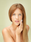 Young blonde woman removing makeup Royalty Free Stock Photo