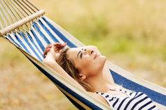 Young blonde woman resting on hammock Stock Photography