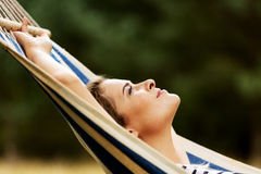 Young blonde woman resting on hammock Stock Photos