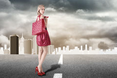Young blonde woman with shopping Stock Photo