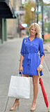 Young blonde woman shopping downtown Royalty Free Stock Image