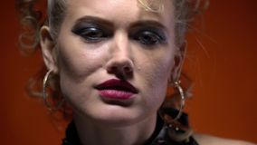 Young girl wearing spiked leather gloves showing the sign of the horns, rocker woman. Young blonde woman showing the sign of the horns wearing black leather stock video footage