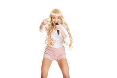 Young blonde woman singer. Royalty Free Stock Image