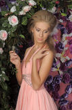 Young blonde woman in a smart pink dress Royalty Free Stock Images