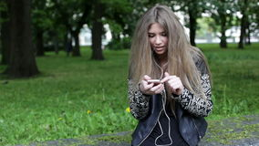 Young blonde woman with smartphone stock video footage