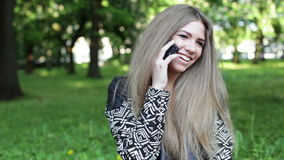 Young blonde woman with smartphone stock video