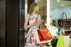 Young blonde woman with some shopping bags in the mall Royalty Free Stock Image