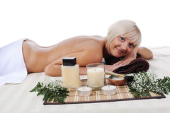 Young blonde woman at spa procedure Royalty Free Stock Image