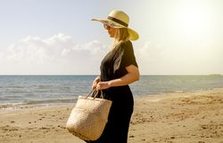 Woman Relaxing Walking On The Beach In Summer royalty free stock photo