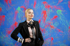 Young blonde woman in a stylish suit against grunge wall Royalty Free Stock Image