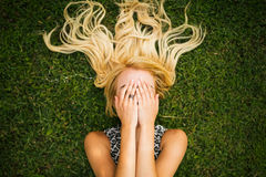Young blonde woman summer day relaxing Royalty Free Stock Photography