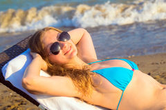 Young blonde woman takes sunbathing Royalty Free Stock Images