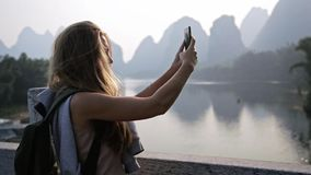 Woman Taking Picture stock footage