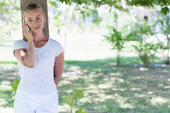 A young blonde woman talking on a phone royalty free stock images