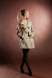 Young blonde woman in topcoat. Stock Photography