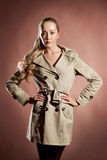 Young blonde woman in topcoat. Royalty Free Stock Photos