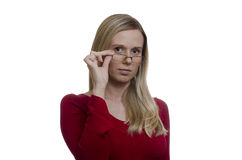 Woman touching her glasses on white background Stock Image