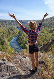 Young blonde woman tourist   on a cliff over the river Berd Royalty Free Stock Images