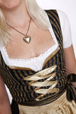 Young blonde woman in traditional bavarian costume Stock Photos