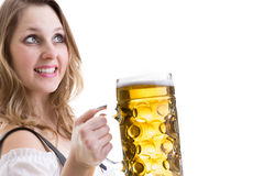 Young blonde woman in traditional bavarian costume on white background Royalty Free Stock Photos