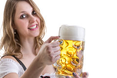 Young blonde woman in traditional bavarian costume on white background Stock Photos