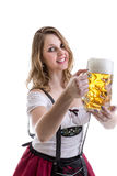 Young blonde woman in traditional bavarian costume on white background Royalty Free Stock Photography
