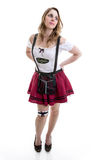 Young blonde woman in traditional bavarian costume on white background.  stock images