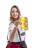 Young blonde woman in traditional bavarian costume on white background Stock Photography